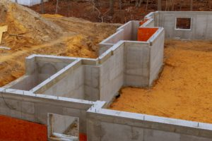 Waterproofing a new house foundation with cement filled of a private house